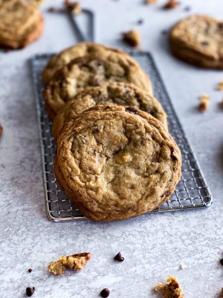 Toffee chocolate chip cookies spread out on a grater