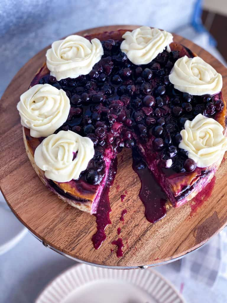 A slice missing of blueberry cheesecake