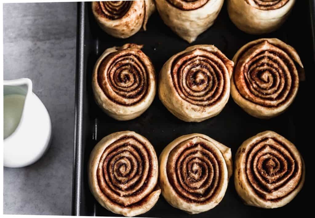 Raw dough of the best gooey cinnamon rolls made from scratch showing off the cinnamon roll filling.