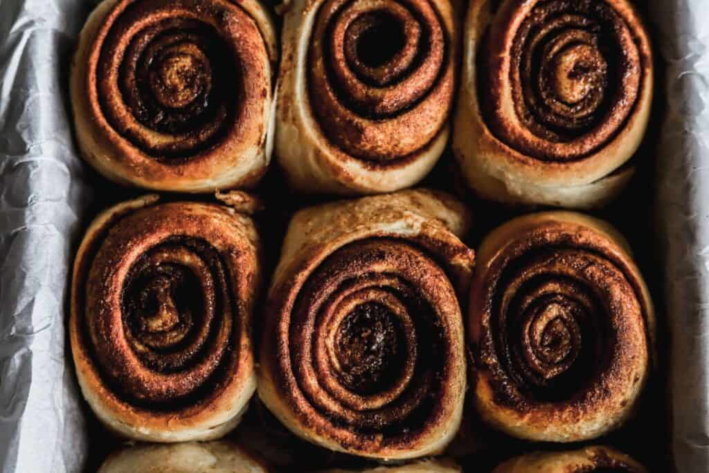Best gooey cinnamon rolls without icing showing off how soft and fluffy they are.