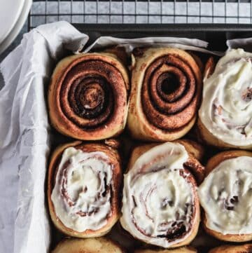 Best gooey cinnamon rolls with some of them iced with cream cheese frosting.