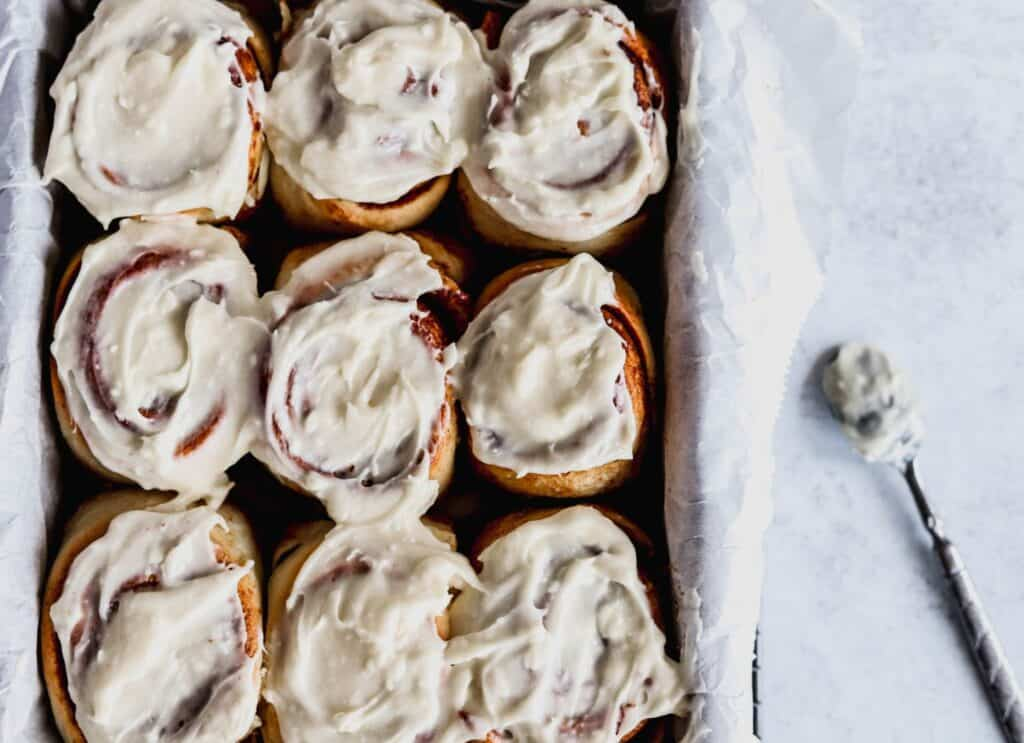 Soft, fluffy, best gooey cinnamon rolls with cream cheese icing.