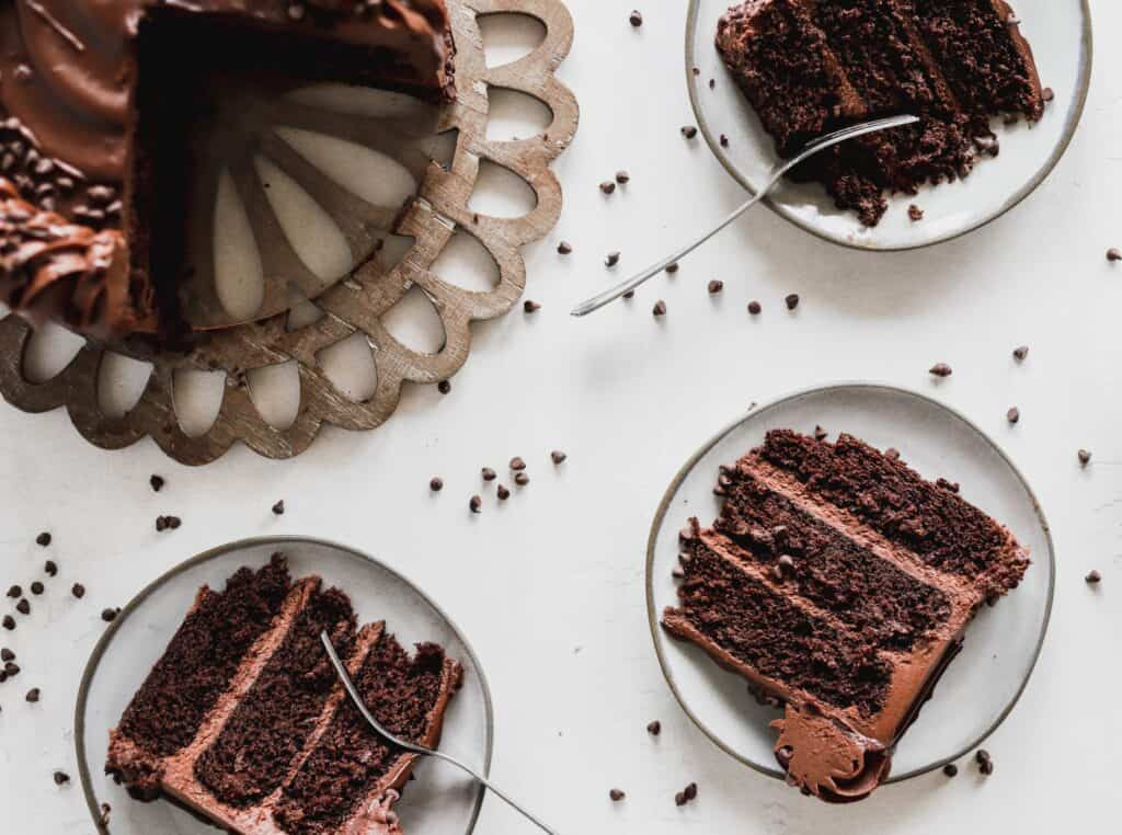 slices of triple chocolate cake that is moist and cut for a birthday party
