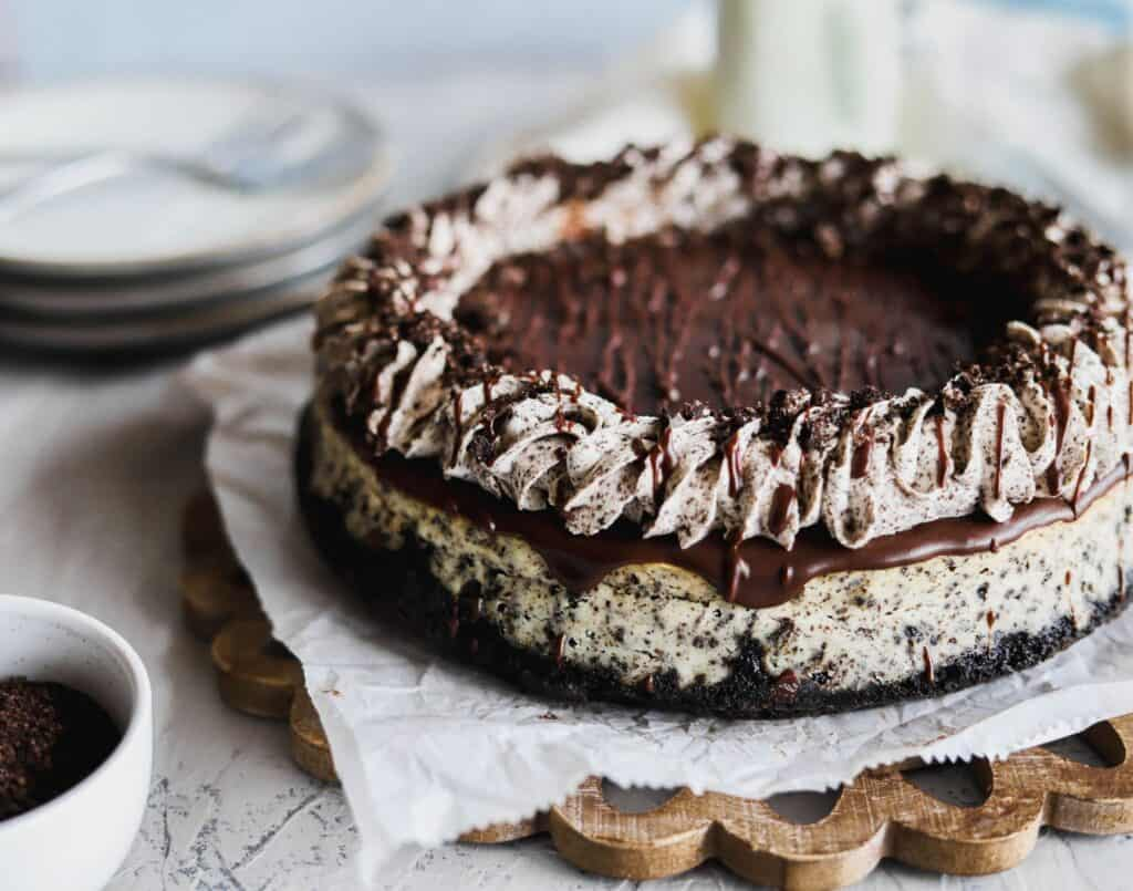 Oreo cheesecake baked on an oreo crust that is creamy and topped with oreo whipped cream.