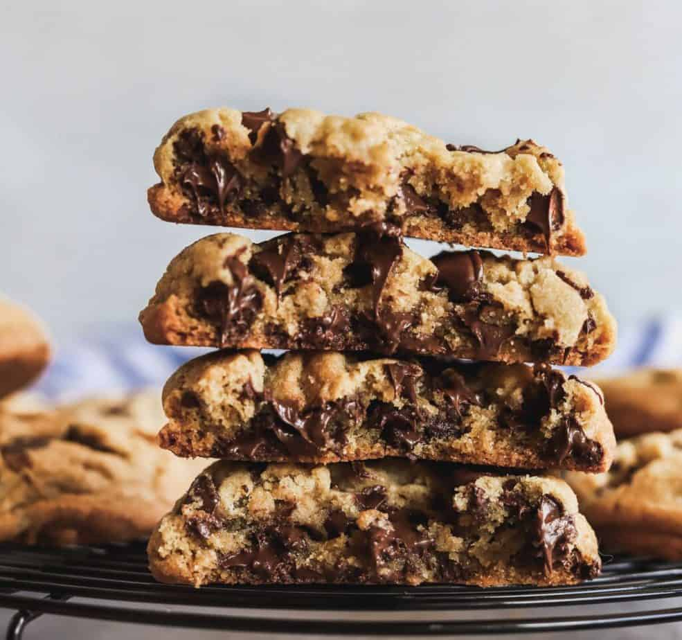A stack of brown butter chocolate chip cookies that is chewy, gooey, and bakery style.