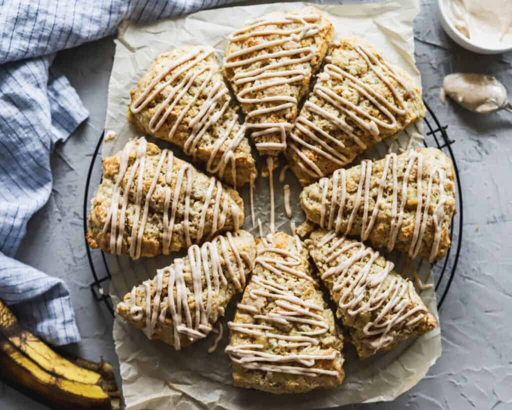 Easy cinnamon banana scones are moist and fluffy on a cooling rack.