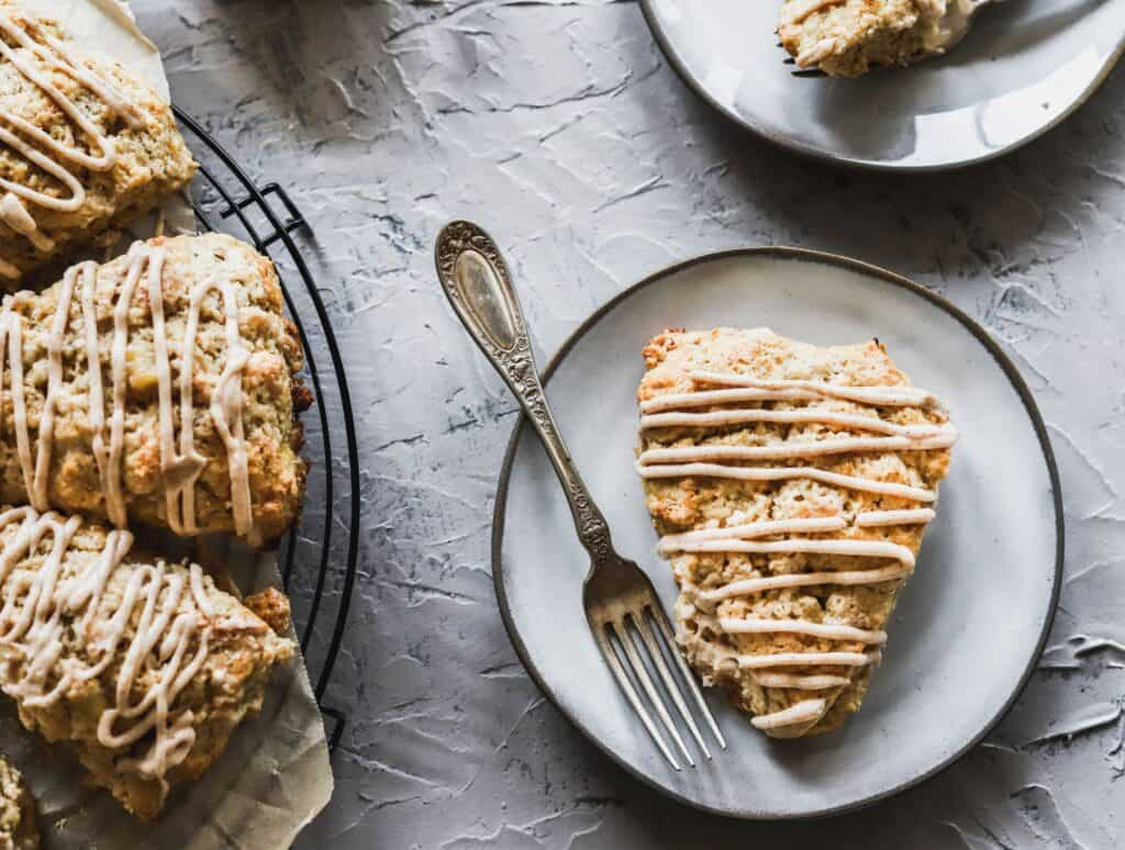 1 easy cinnamon banana scones on a plate showing off the cinnamon cream cheese glaze.