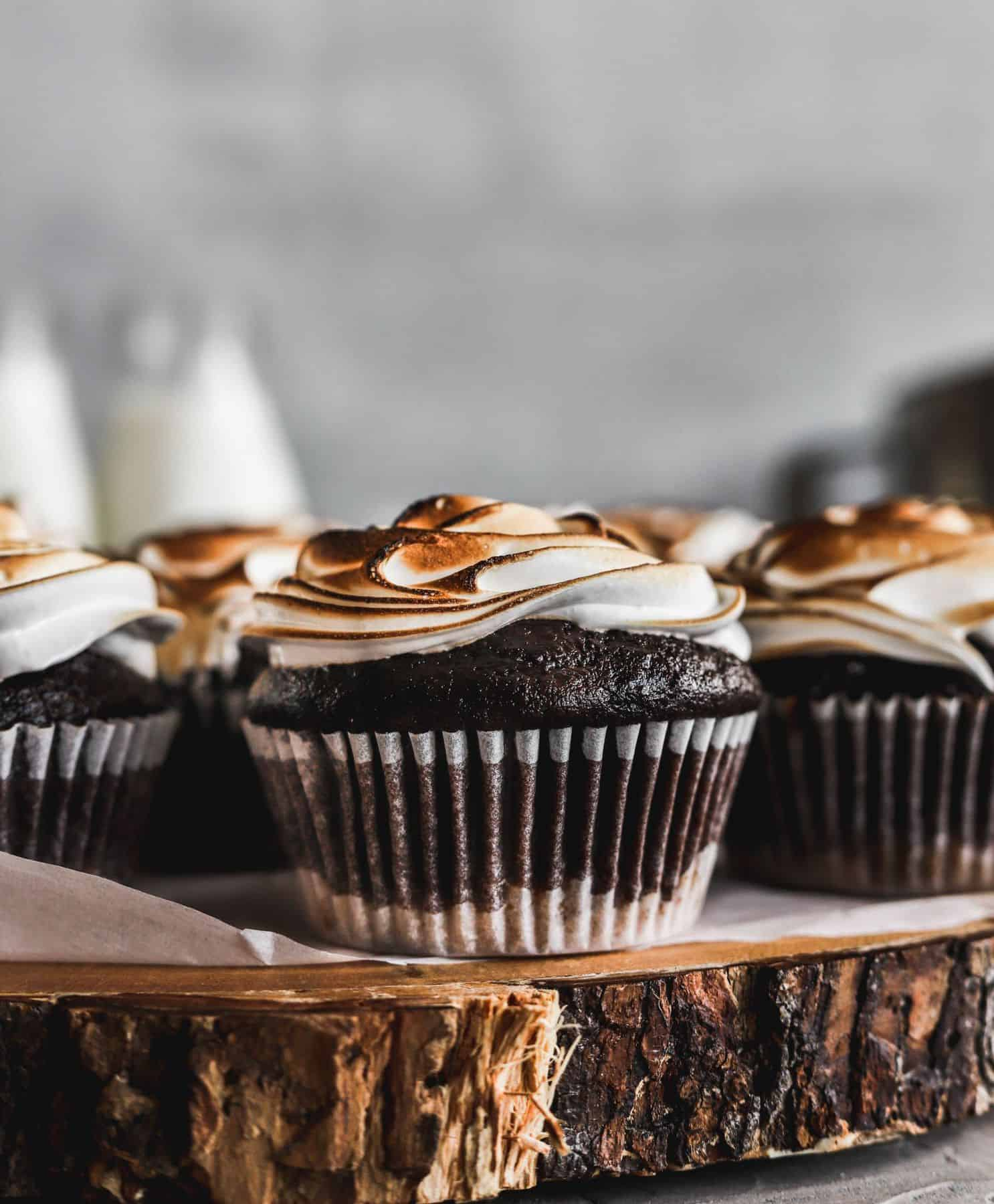 Toasted S'mores Cupcakes that are easy to make chocolate cupcakes filled with hot fudge.