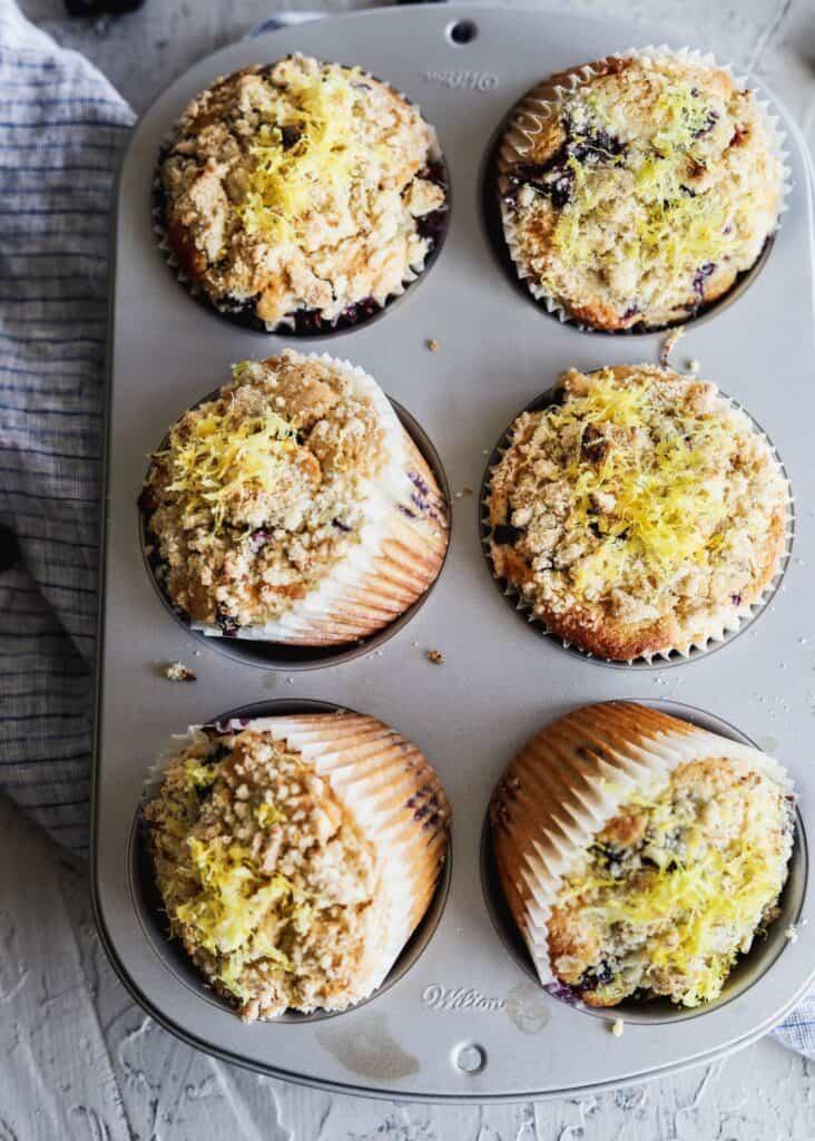 6 lemon blueberry muffins in a jumbo muffin tin.