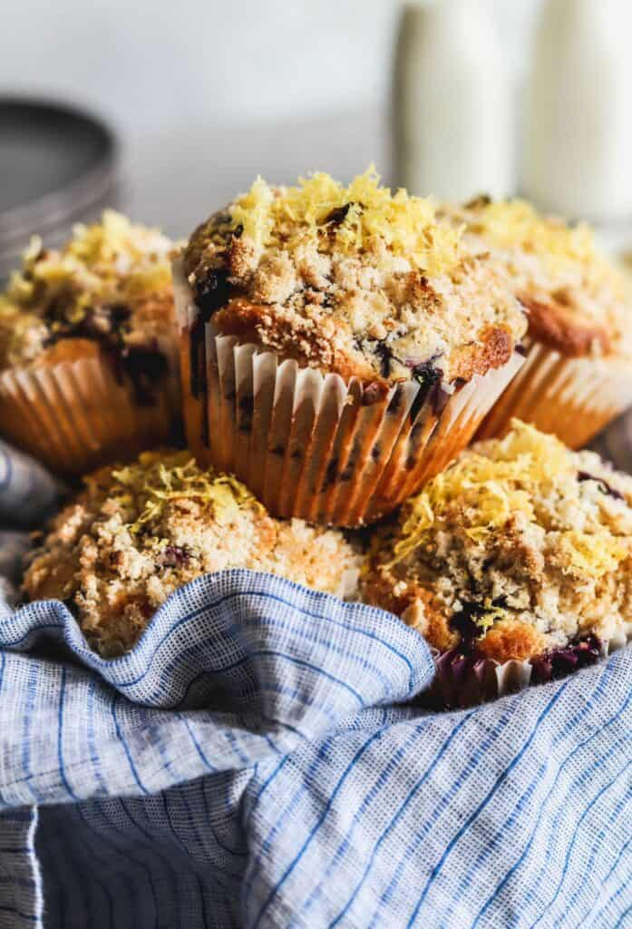 Easy lemon blueberry muffins in a bowl with a napkin.