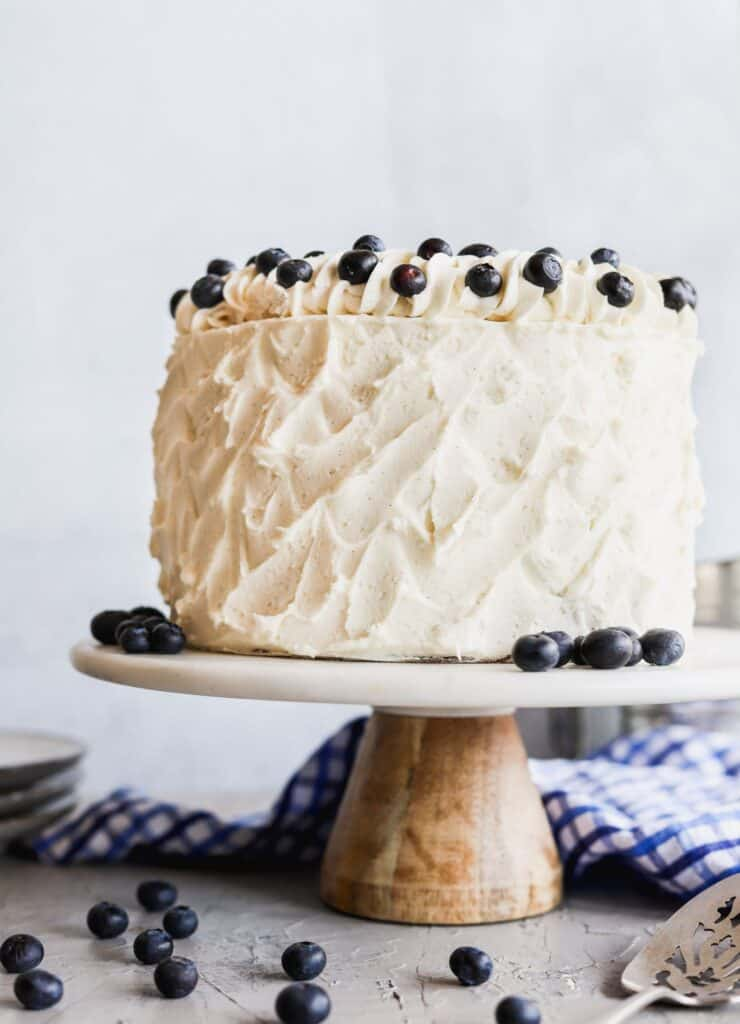 Blueberry jam and cream cake on a cake stand.