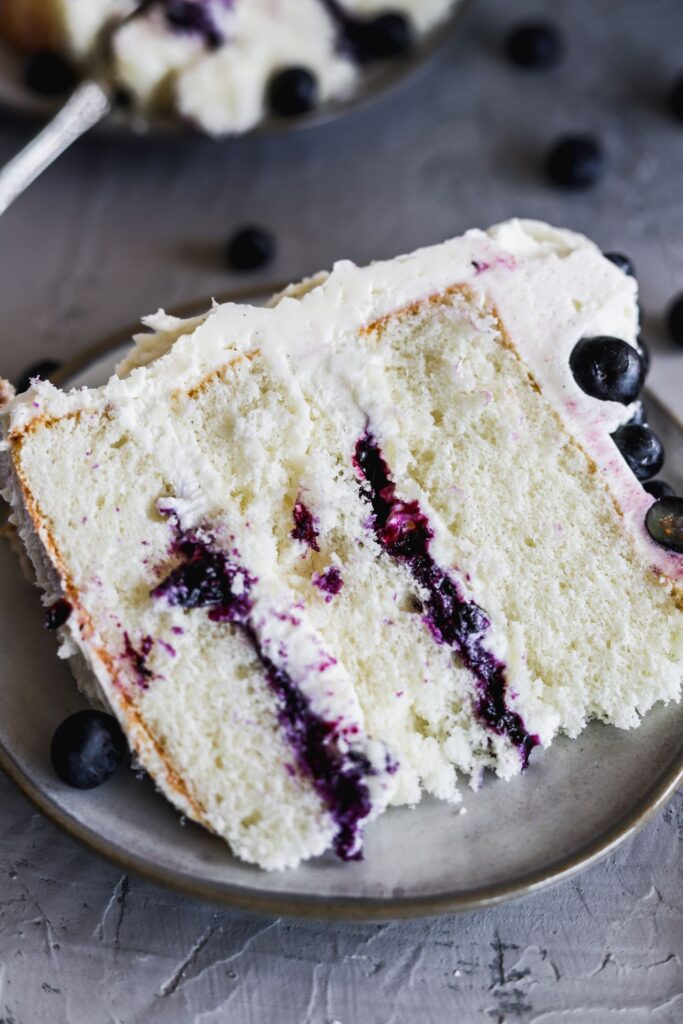 1 slice of blueberry jam and cream cake showing off the whipped cream cheese.