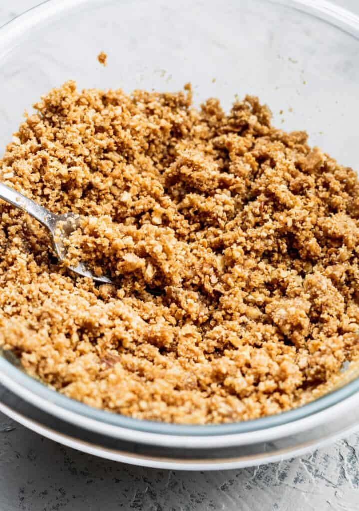 pecan graham cracker crumbs in a glass bowl.