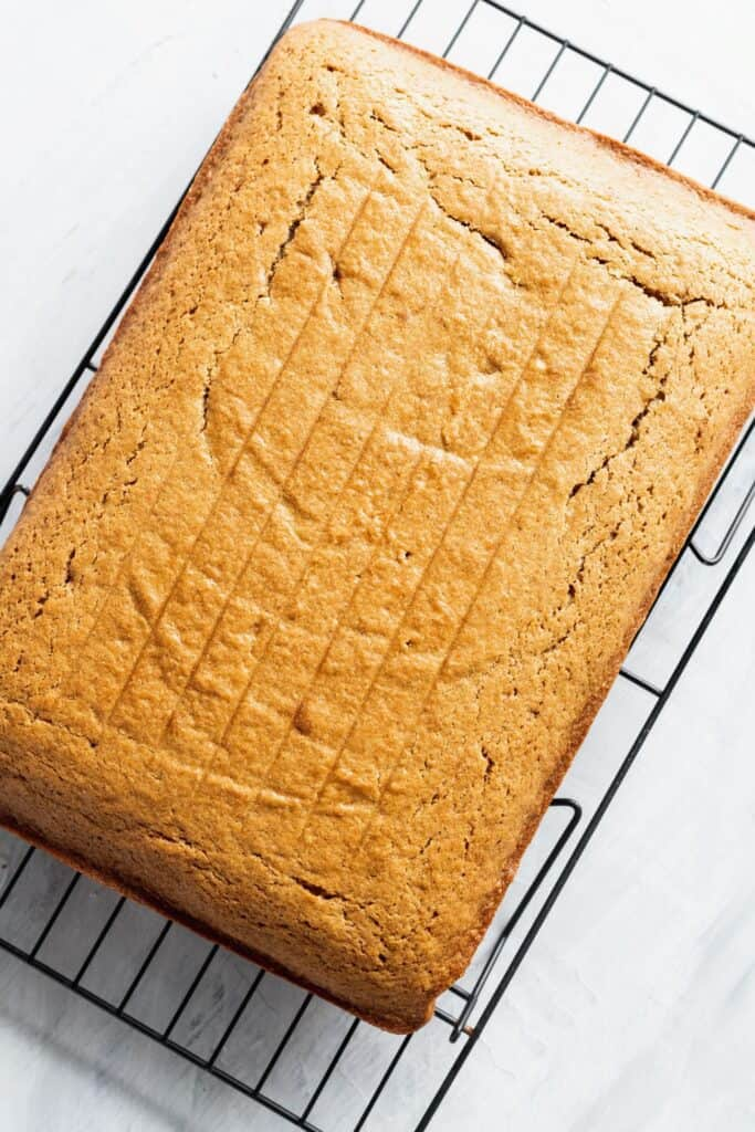 Spice sheet cake on a cooling rack.
