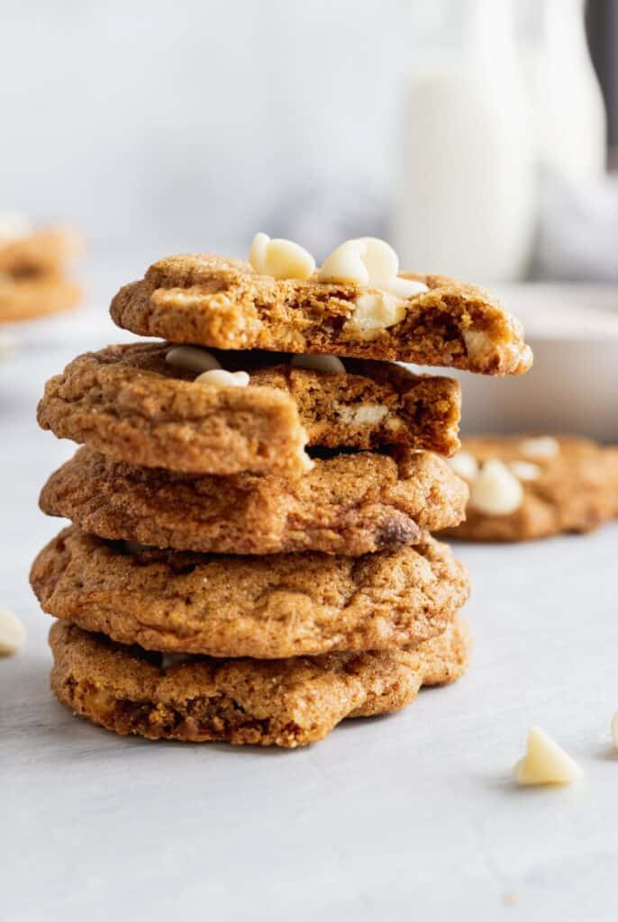A big stack of white chocolate pumpkin snickerdoodle cookies.