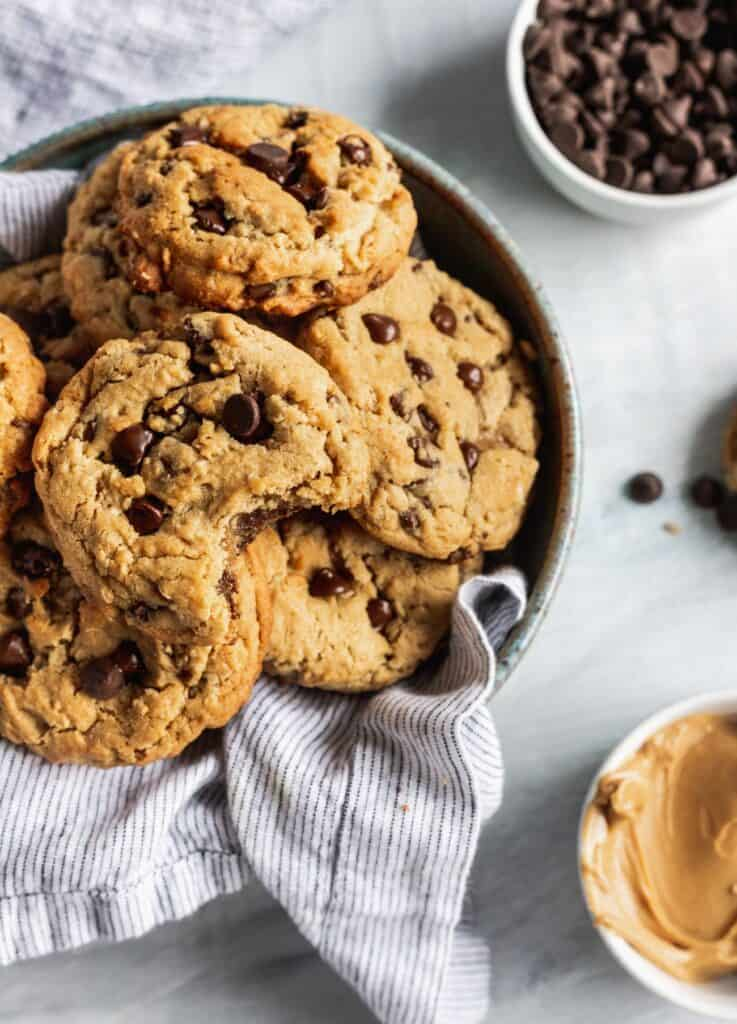 Oatmeal peanut butter chocolate chip cookies in a bowl with a napkin.