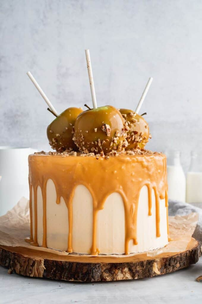 Far away picture of caramel apple spice cake on a wooden board.