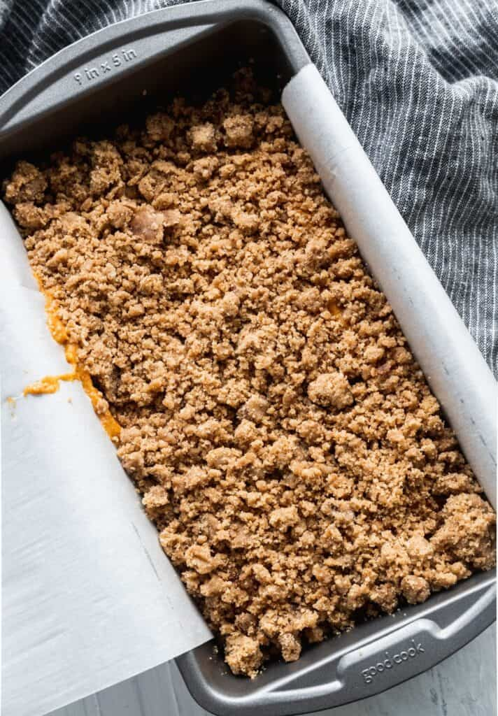 Pumpkin bread with streusel in a loaf pan.