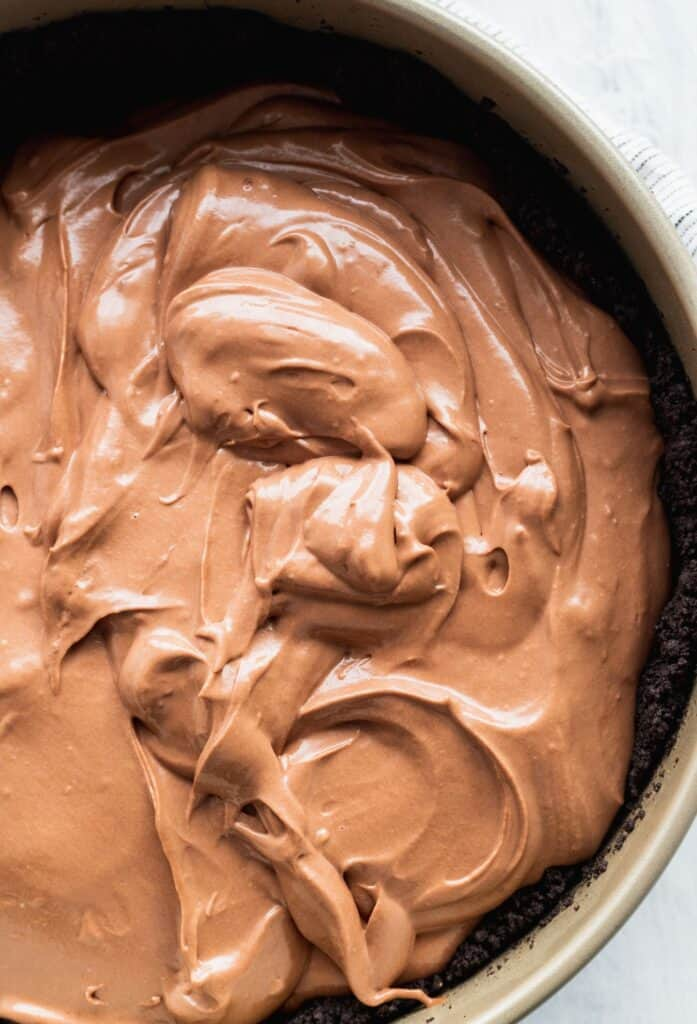 Cheesecake batter in a spring form pan.