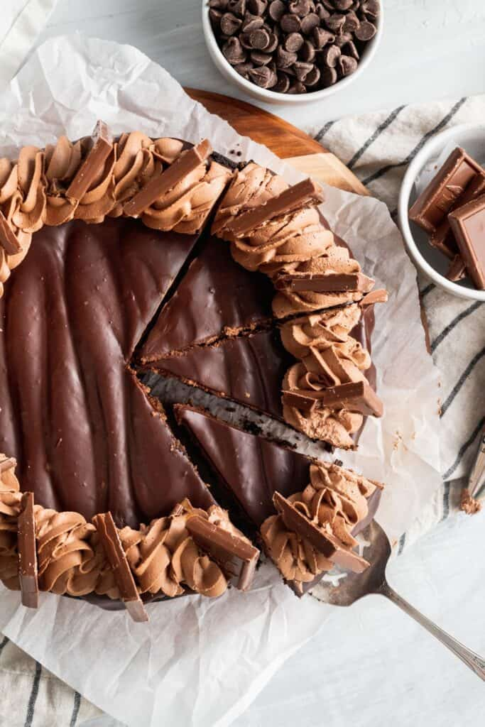 Top view of triple chocolate cheesecake with 3 slices cut out.