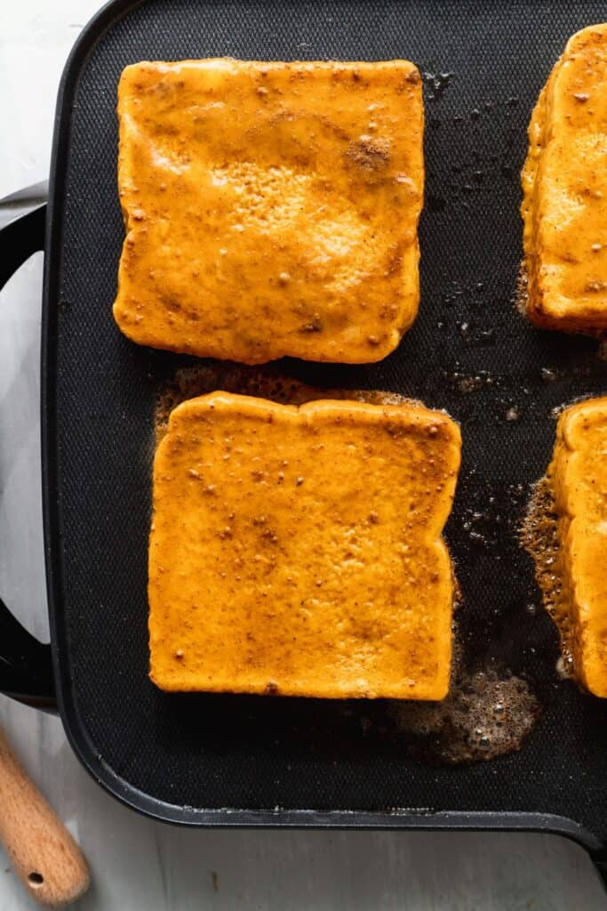 French toast baking on a skillet.