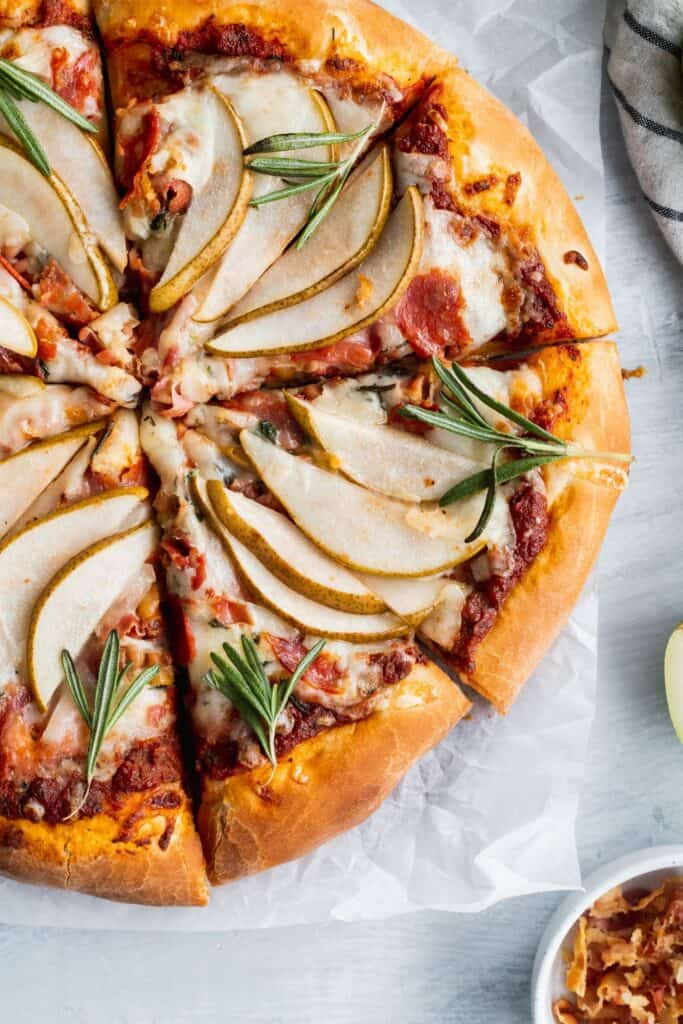 Sliced up homemade pear pancetta pizza.