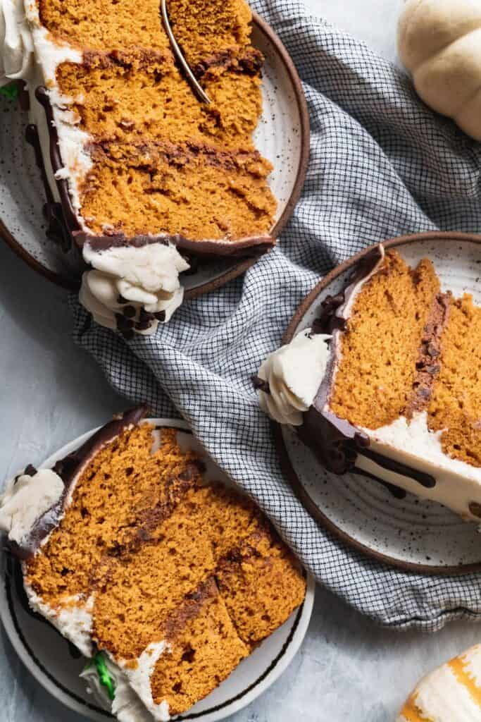 3 slices of pumpkin chocolate chip cake showing the layers