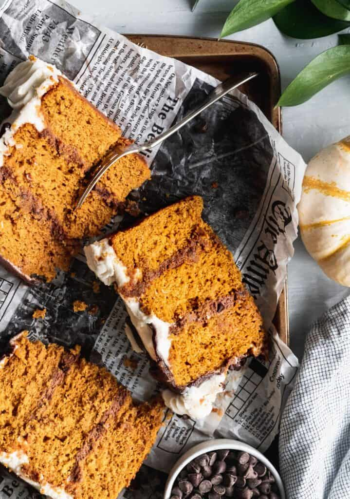 3 slices of pumpkin chocolate chip cake on newspaper.
