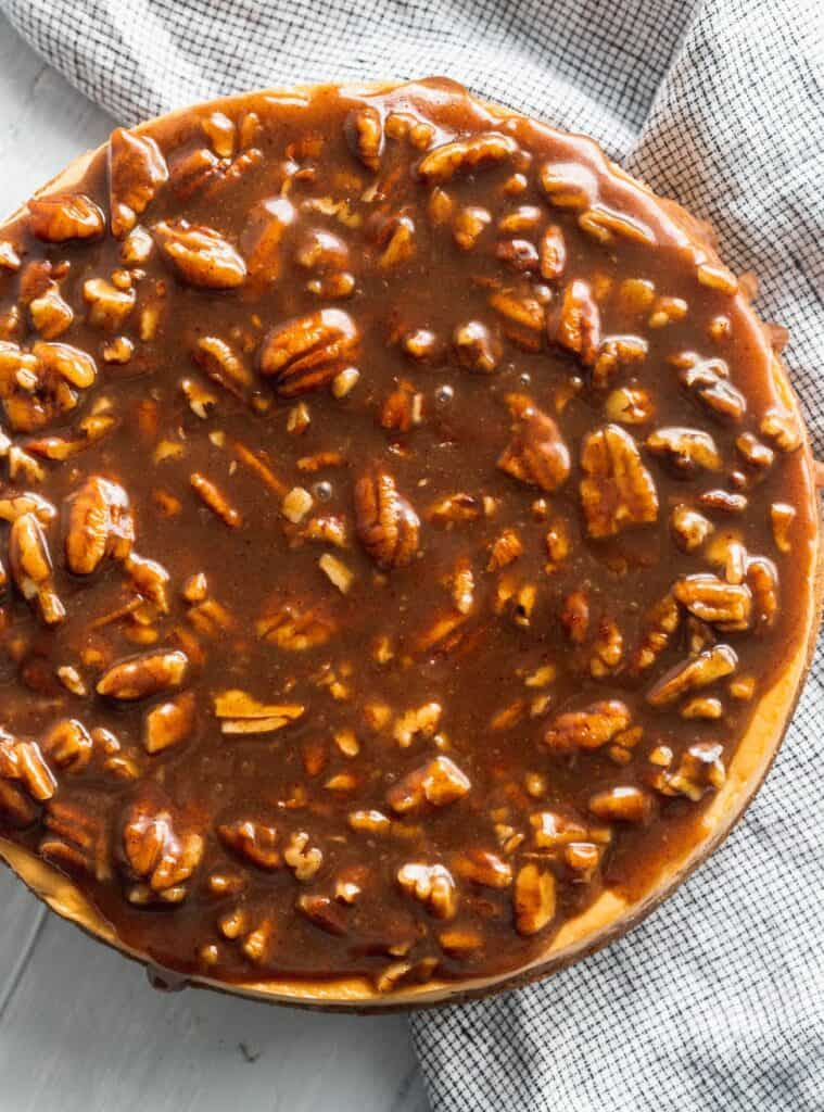 Pecan topping on top of brown sugar cheesecake
