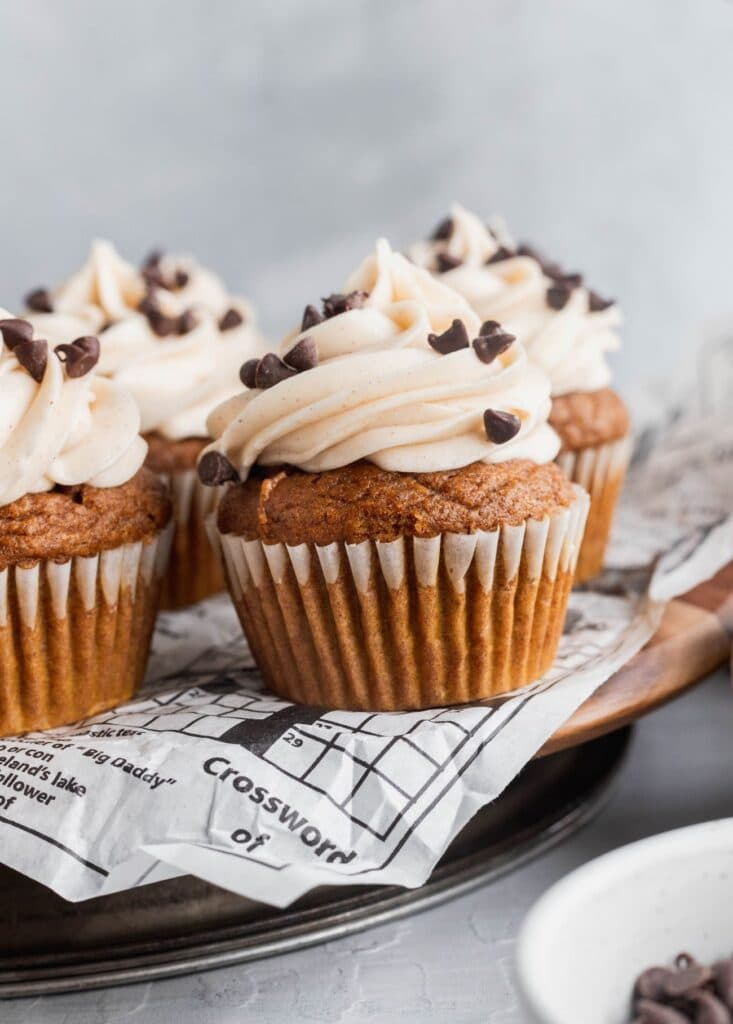 Chocolate stuffed pumpkin cupcakes topped with cinnamon cream cheese frosting.