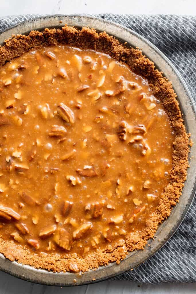 Salted caramel with pecans on top of graham cracker crust.