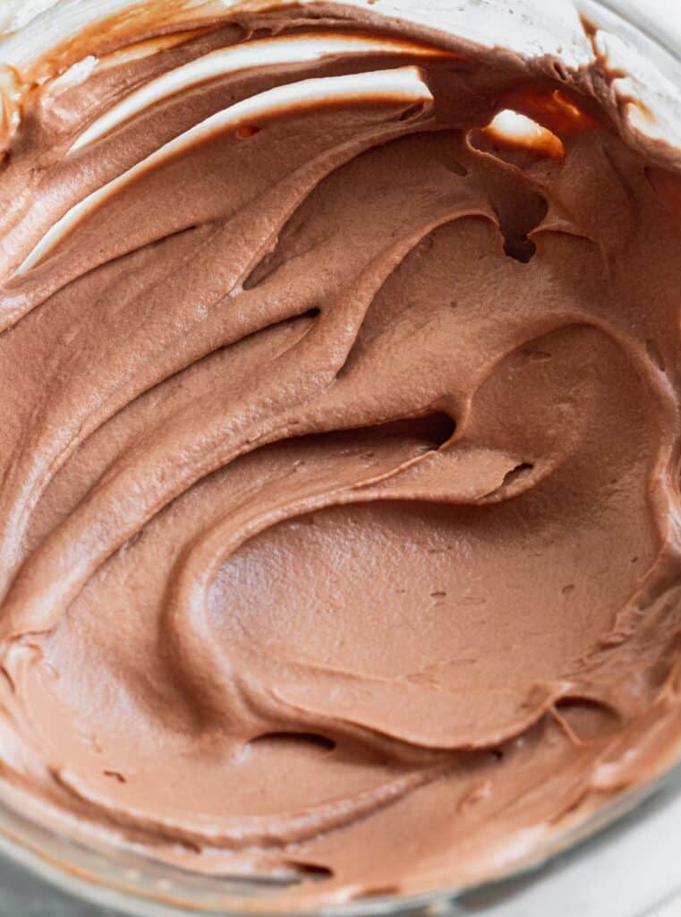 Chocolate cream cheese icing in a bowl.