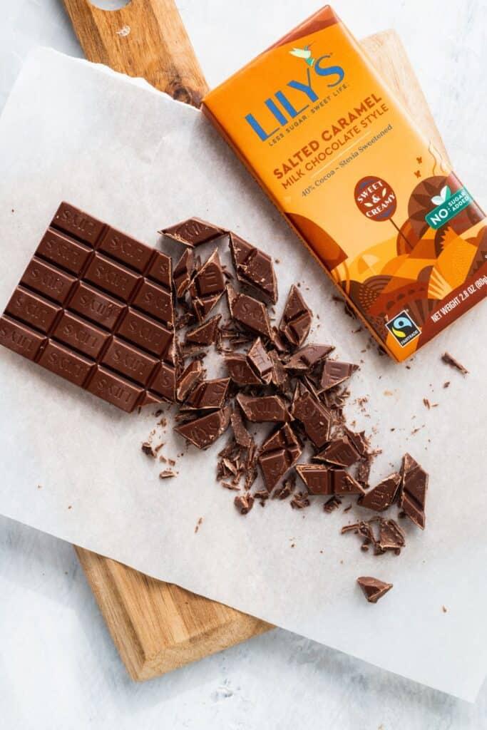 Cut up chocolate on cutting board.