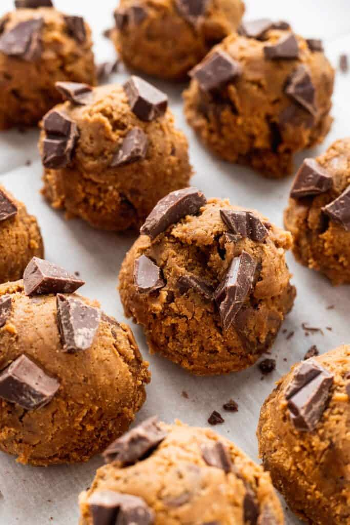 Gingerbread cookie dough balls with chocolate on top.