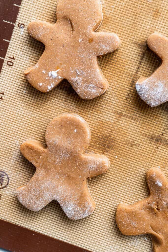 Gingerbread men on a cookie sheet.