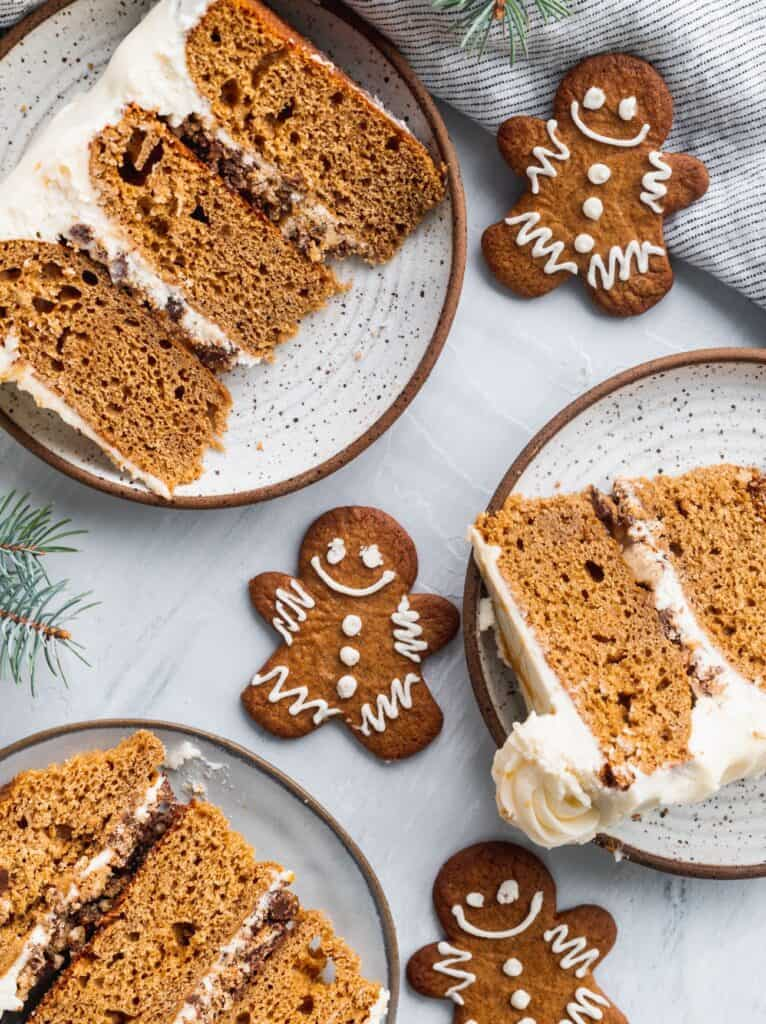 3 slices of moist gingerbread cake with cream cheese icing.