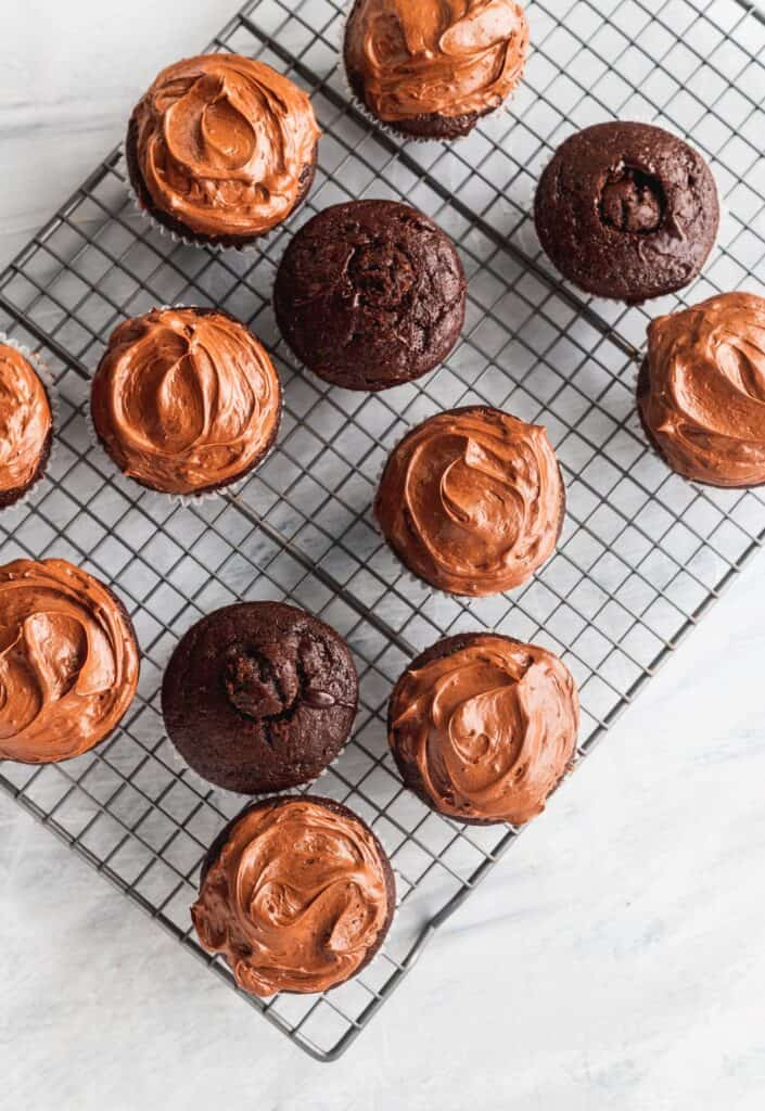 chocolate frosting decorating cupcakes.