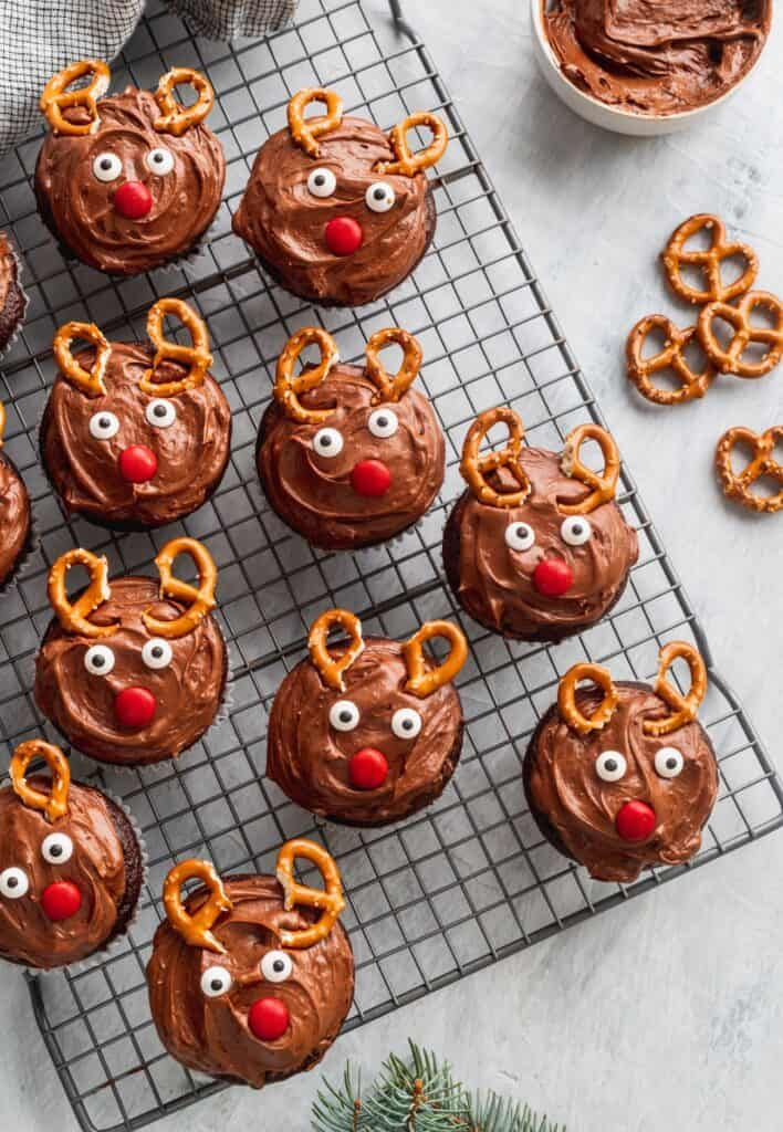Christmas reindeer cupcakes on a cooling rack.