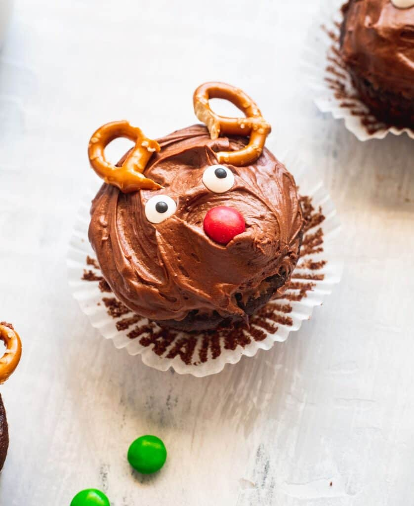 Christmas reindeer cupcake with wrapper pulled down.