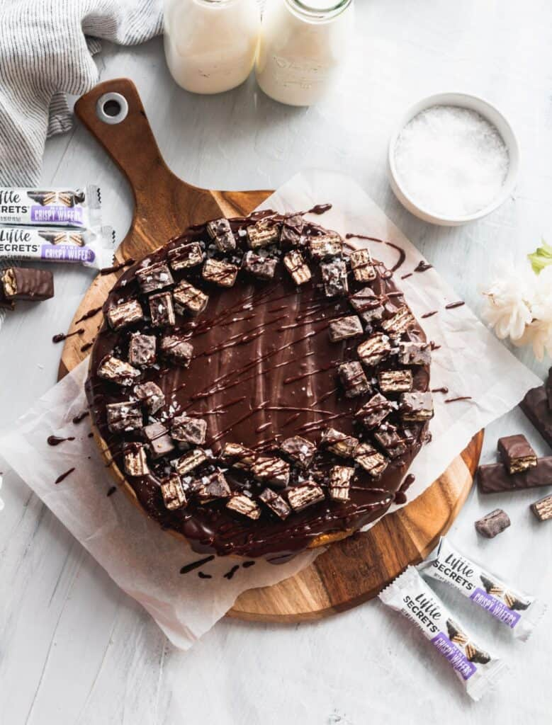 Chocolate bar cheesecake on a cutting board.