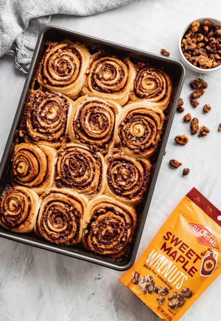 Walnut cinnamon rolls in a pan with no icing.