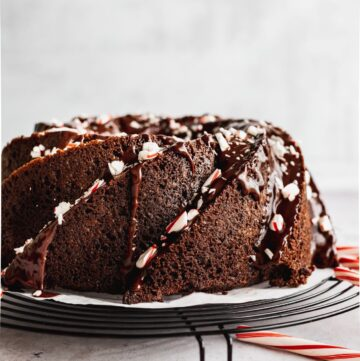 Chocolate peppermint cake on a wire rack.