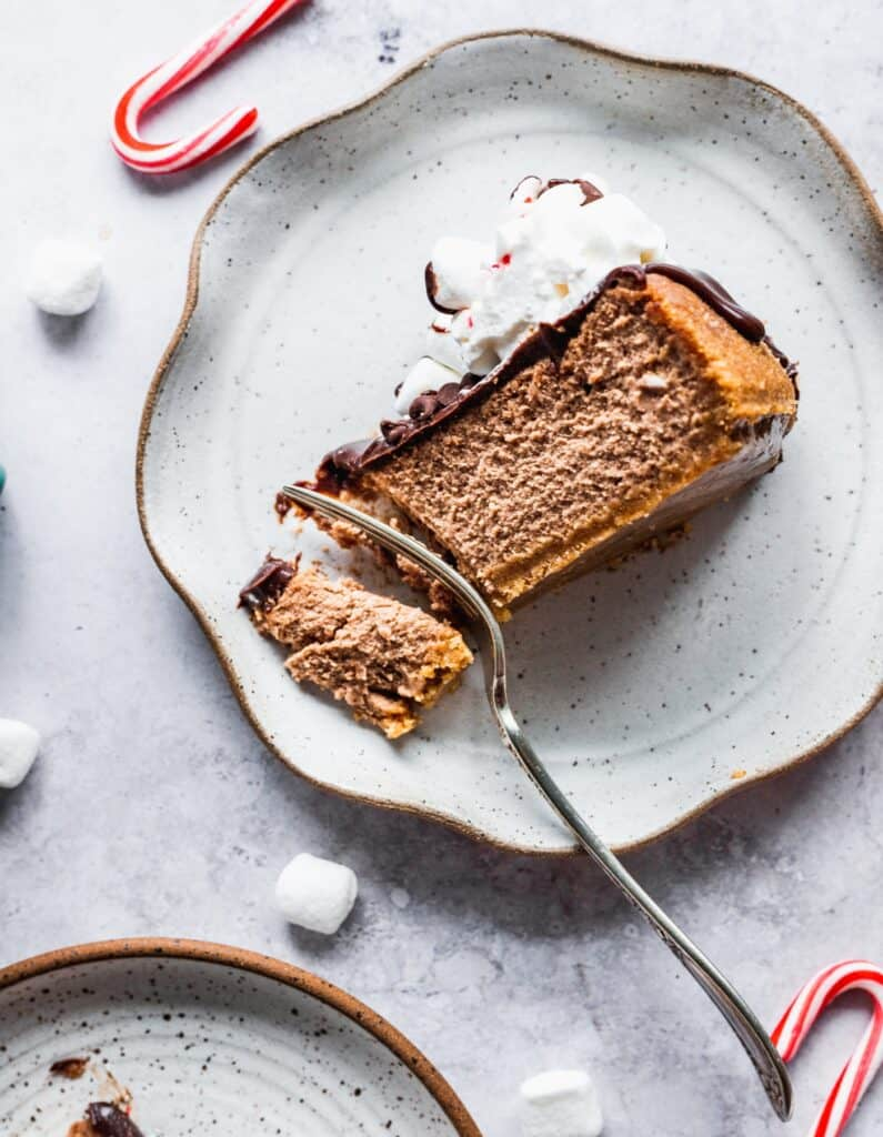 1 fork inserted into hot chocolate cheesecake slice.