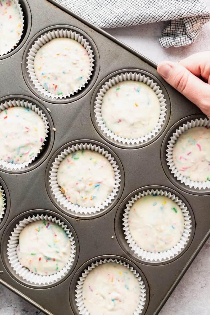 Cheesecake batter in a muffin tin.