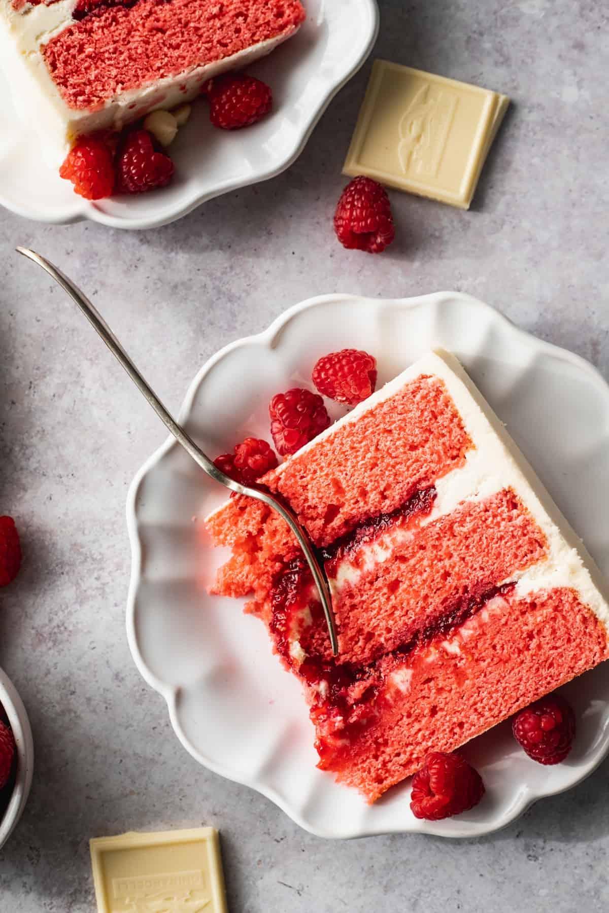 Raspberry white chocolate cake on a plate.