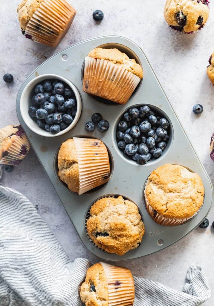 Sour cream blueberry muffins in the muffin tin.