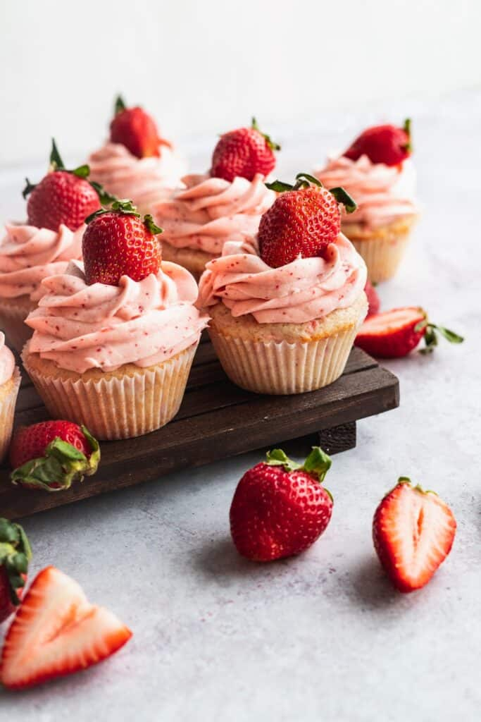 Side view of strawberry cupcakes.