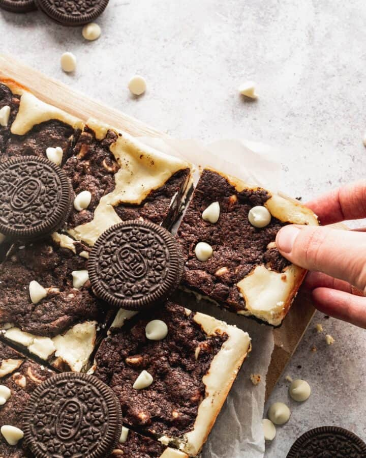 Oreo cookie dough bars with a hand pulling one away.