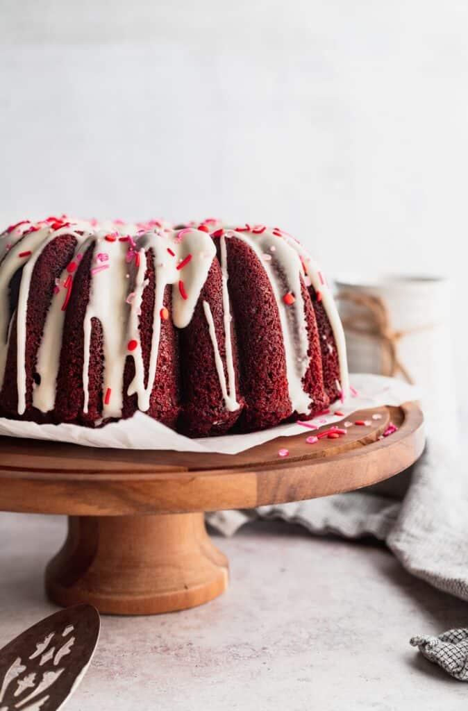 Close up of red velvet bundt cake on cake stand.