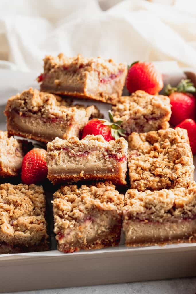 Peanut butter cheesecake bars in a container.